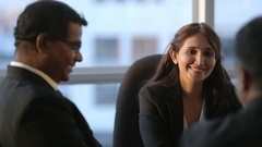 MS SELECTIVE FOCUS Business people talking in board room / Singapore Stock Footage