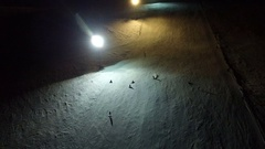 Night skiing and snowboarding at a ski resort. Stock Footage