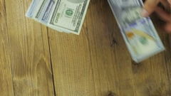 Dollar Banknotes Falling on a Wooden Table Stock Footage