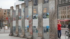 Tourists at Berlin wall remains at Potsdamer Platz, Germany Stock Footage