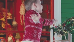 The little boy in the Christmas plays and enjoys interior Stock Footage