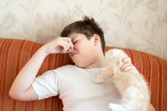 Teen turns due to unpleasant odor from cat Stock Photos