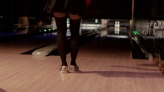 Sexy blonde in short black dress playing bowling Stock Footage