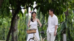 MS PAN Mid adult couple walking through park / Singapore Stock Footage