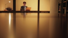 MS SELECTIVE FOCUS Businessman works on his lap top late at night / Singapore Stock Footage