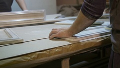 Female carpenter polishing board on the furniture factory Stock Footage