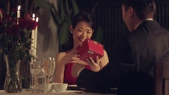 MS Mid-adult man giving present to his girlfriend / Singapore Stock Footage