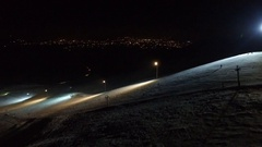 Ski resort slope on the night city background. Stock Footage
