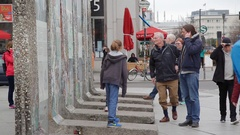 Tourists with children at Berlin wall remains monument, Potsdamer Platz Stock Footage