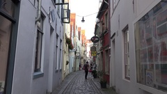 4k Antique architecture and small alley zoom in city Bremen famous area Schnoor Stock Footage