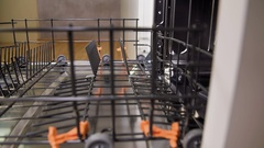 Making more space for dishes and putting down one of the racks Stock Footage