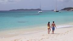 Aerial video of a couple walking on tropical beach, Virgin Gorda Stock Footage