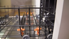 Adjusting the rack for the dishes which will wash in the dishwasher Stock Footage