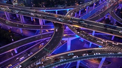 Elevated view of stacked road junction & Shanghai skyline at dusk, Shanghai, Stock Footage