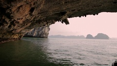 WS View to other side of rock arch in Ha Long Bay / Vietnam Stock Footage