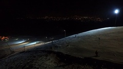 Ski resort slope on the night city background. Stock Footage