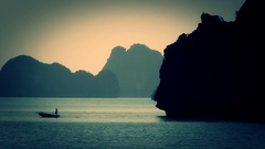WS Person rowing fishing boat in Ha Long Bay / Vietnam Stock Footage