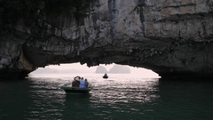 MS Tourists in small boat in Ha Long Bay / Vietnam Stock Footage