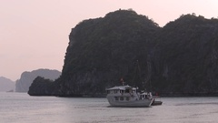 WS Boats in in Ha Long Bay surrounded by Limestone Formations / Vietnam Stock Footage