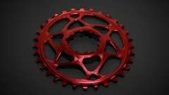 Red bicycle oval chainring rotate at dark background in loop Stock Footage
