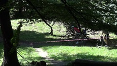 Competition cyclists in a forest on a trail bordered with plastic tape Stock Footage