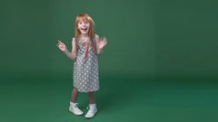 Cute little ginger girl playing  the ape and fooling Stock Footage