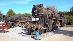 Small visitor of locomotive museum Stock Footage
