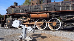 Panning old steam locomotive and switch Stock Footage