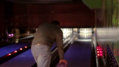 Caucasian man with a beard playing bowling Stock Footage