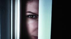 4K Thriller Woman Eye Looking in Door Gap, zoom in Stock Footage