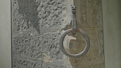 Medieval Decorative Door Knocker in Brick Wall - 29,97FPS NTSC Stock Footage