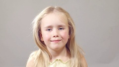 Girl much smiling without front teeth. in the room a soft smooth light Stock Footage