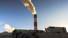 Power plant emitting smoke and vapor in cold weather Stock Footage