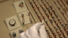 A goldsmith expert checks of jewerly Stock Footage