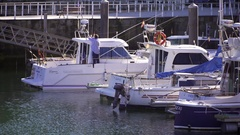 Fishing boats and leisure yachts in a Spanish harbour Stock Footage