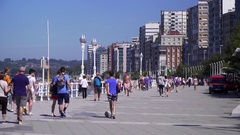 People stroll along the boulevard in a Spanish holiday city Stock Footage
