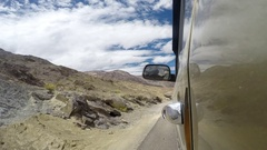 4x4 off-road car goes by the Himalayas mountain road time lapse video Stock Footage