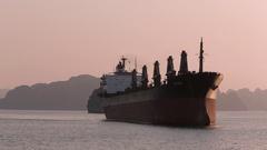 WS Large ship in bay at sunset / Ha Long Bay, Vietnam Stock Footage