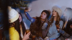 Group of happy female friends drink mulled wine and taking selfie in winter Stock Footage
