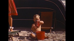 Vintage 16mm film, 1946, California toddler playing at beach Stock Footage