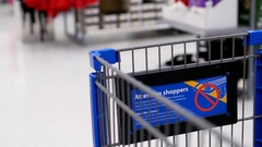 Shopping cart concept with blur motion background inside Walmart store Stock Footage