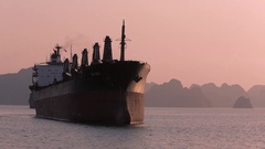 WS Container ship in bay at sunset / Ha Long Bay, Vietnam Stock Footage