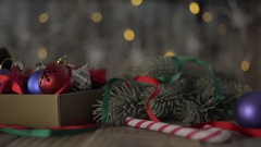 A box of Christmas decorations on an old wooden table. Stock Footage