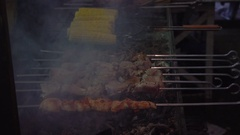 Meat and corn on grill. Meat fried on mangal. Cooking pork meat on hot charcoal. Stock Footage