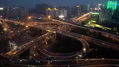 Busy elevated stacked road junction at dusk, Shanghai, China Stock Footage