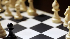 Chess board with king and pawn Stock Footage