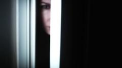 4K Thriller Woman Eye Looking in Door Hole Gap, zoom in Stock Footage