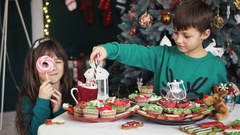 Kids Playing near Christmas Tree Stock Footage