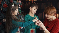 Mother with Kids Playing near Christmas Tree Stock Footage