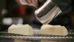 Confectioner pours caramel syrup cheesecake Stock Footage